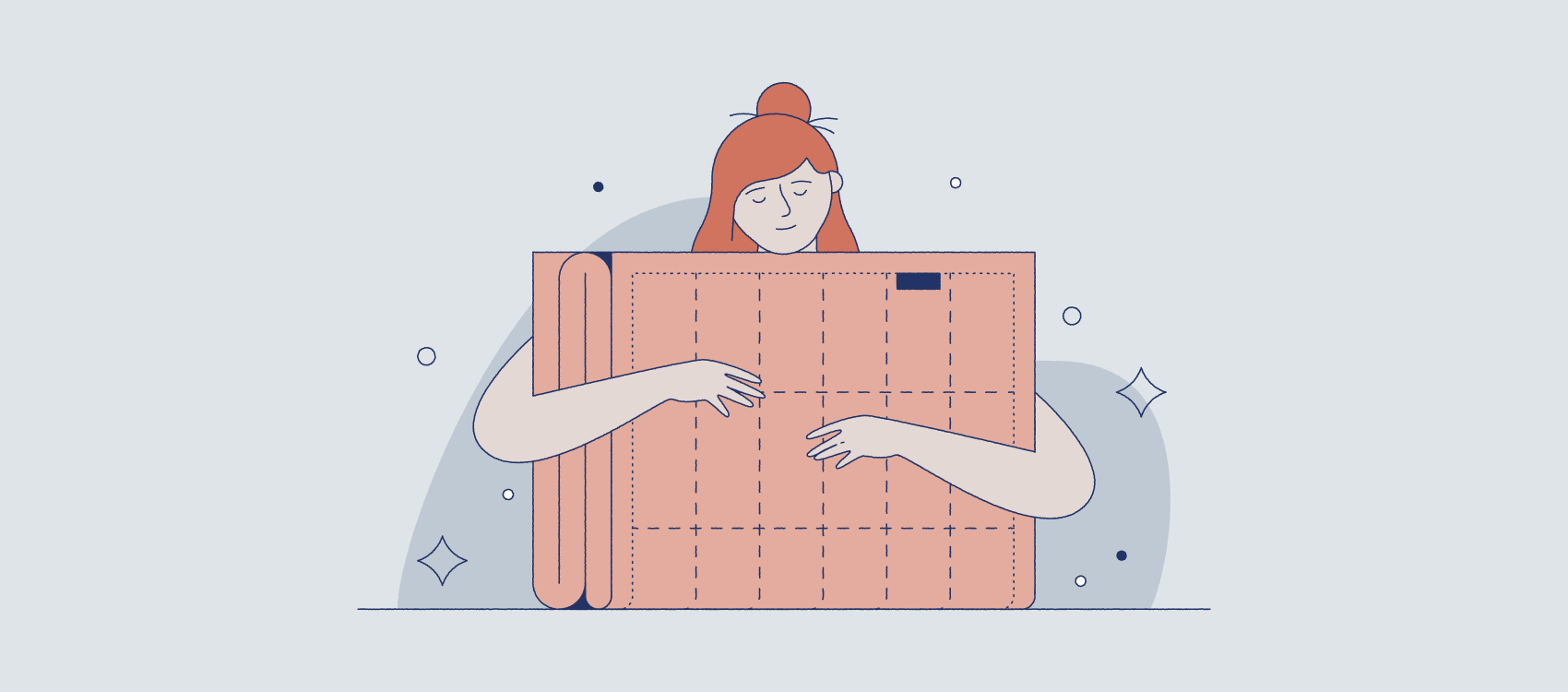woman with red hair hugging a weighted blanket