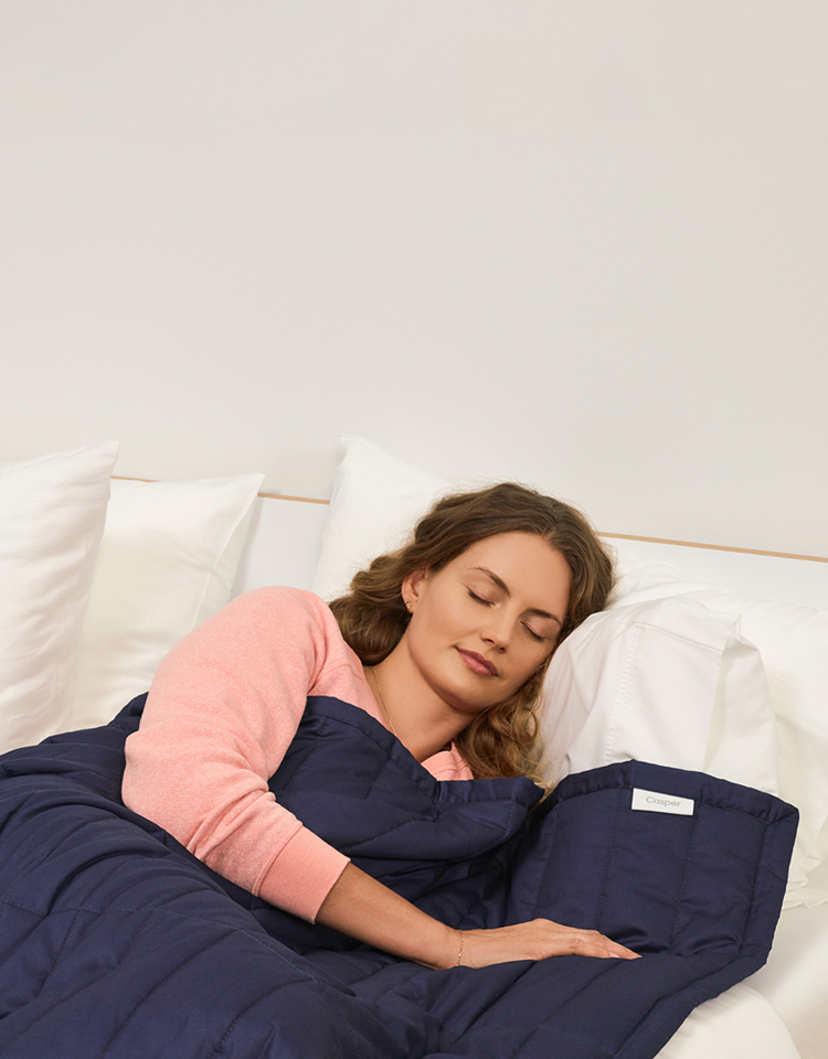 woman sleeping with a weighted blanket