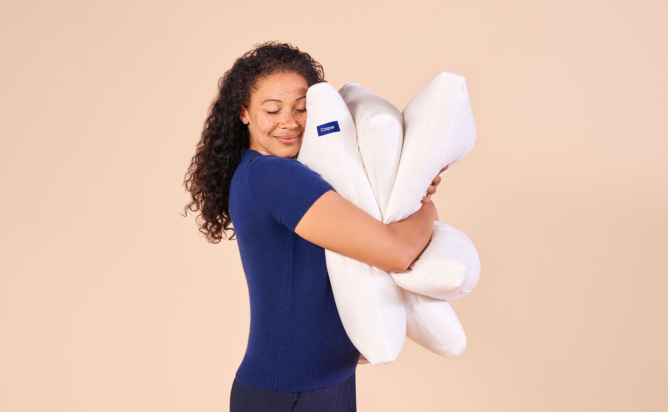 woman hugging pillows