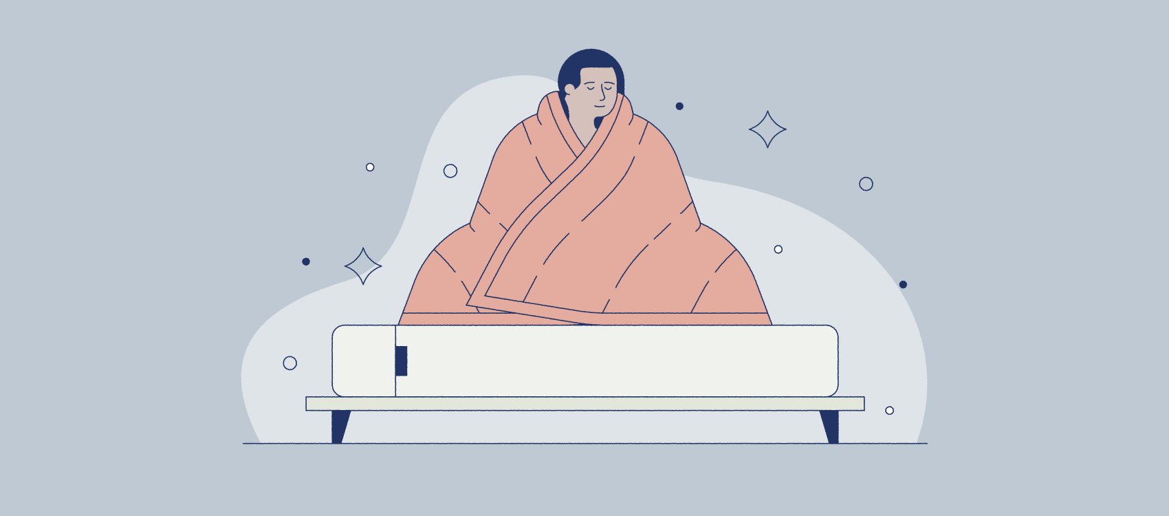 a person wrapping themselves in a weighted blanket
