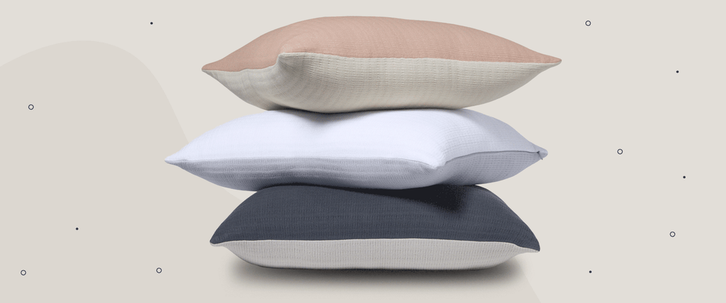 Pillows stacked on top of one another.
