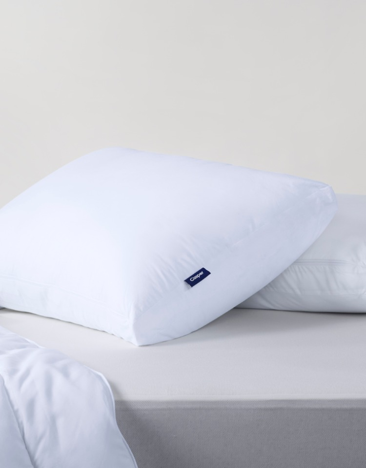White pillow on the bed