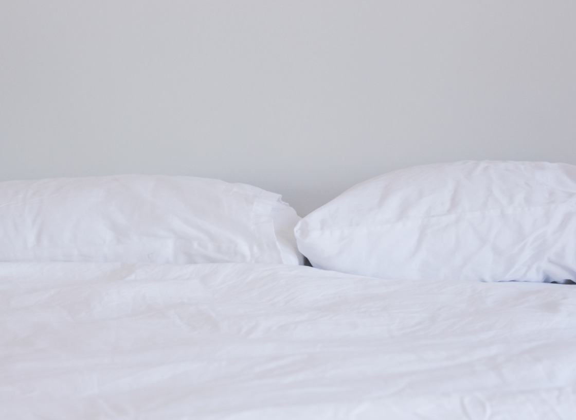 bed with white linen