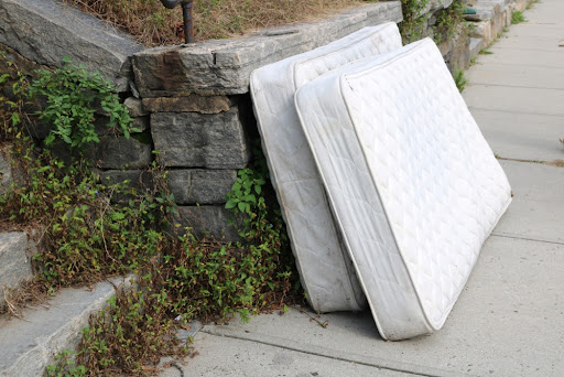 Two old mattresses left in front of the house