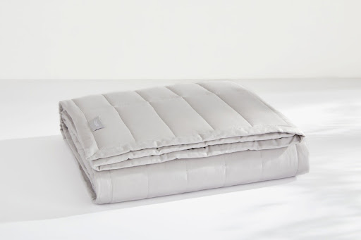 Folded white weighted blanket
