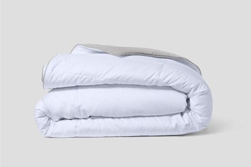 Folded white cooling blanket