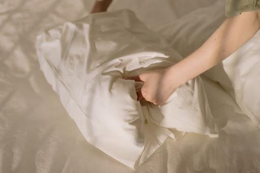 Woman holding soft pillow