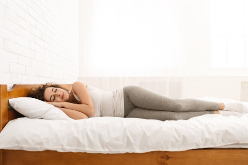 Woman sliping peaceful on her side in bed