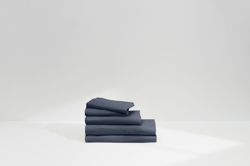 A stack of folded bed sheets